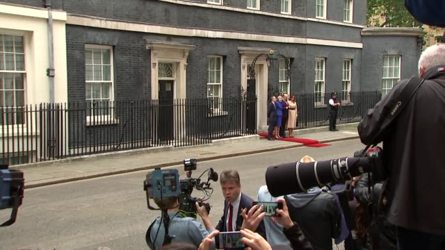 day two arrival at downing street england london downing street ext press gathered outside number 10 / wide shot of theresa may mp and husband philip... - first lady stock-videos und b-roll-filmmaterial