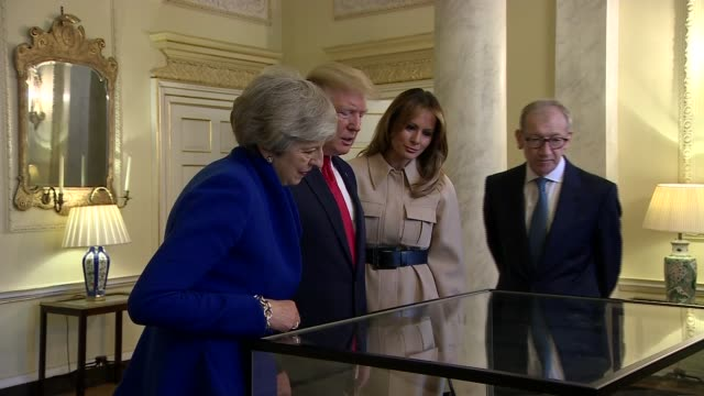 day two donald and melania trump view historic documents inside number 10 england london downing street number 10 int painting on wall / historic... - first lady stock-videos und b-roll-filmmaterial