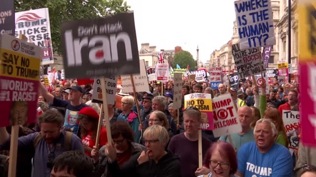 day two protests england london whitehall ext antidonald trump protesters wearing red costumes and white face paint / protester wearing devil costume... - jeremy corbyn stock videos and b-roll footage
