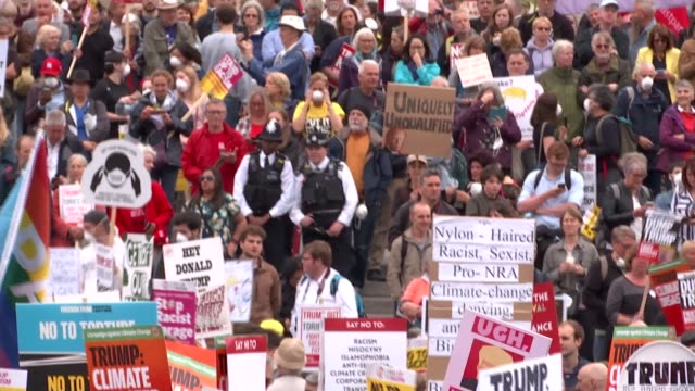 day two protests trafalgar square london uk various shots of antitrump protestors with placards donald trump mannequins along and chants vox pops... - welcome segnale inglese video stock e b–roll