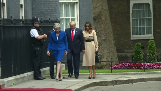 day two trump and theresa may hold joint press conference england london downing street ext donald trump and melania trump along from the beast limo... - state visit stock videos & royalty-free footage
