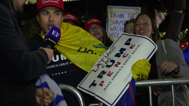 Donald Trump supporters gather across the street from the Hilton Midtown Hotel awaiting the results of the Presidential Election / 6th Avenue of the...