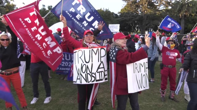 """donald trump supporters hold a """"stop the steal"""" rally on november 7, 2020 in beverly hills. protesters gathered in beverly gardens park and circled... - beverly hills california stock videos & royalty-free footage"""