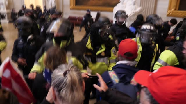 donald trump supporters storm the united states capitol building; usa: washington dc: capitol building: int various shots police clashing with trump... - pushing stock videos & royalty-free footage