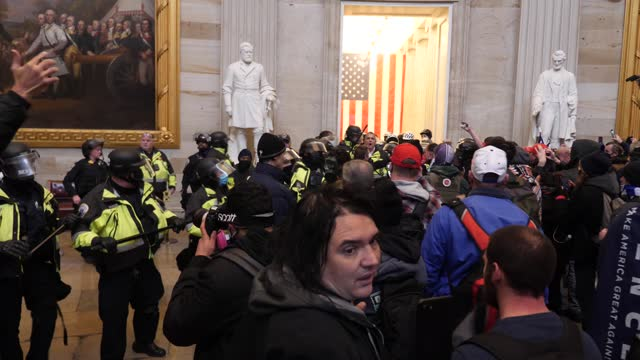 donald trump supporters storm the united states capitol building; usa: washington dc: capitol building: int gv police officiers standing in doorway... - capitol hill video stock e b–roll