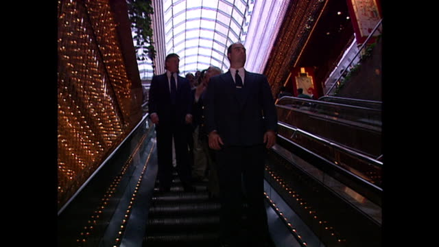 donald trump takes the escalator down to the main level of his casino in atlantic city. - businessman stock videos & royalty-free footage