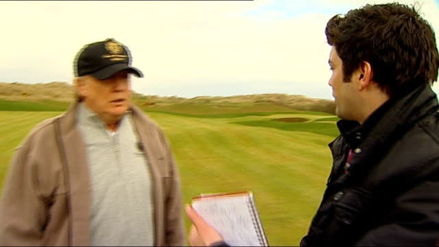 stockvideo's en b-roll-footage met donald trump to appear at scottish parliament committee scotland aberdeenshire aberdeen ext donald trump along on golf course donald trump interview... - verschijning