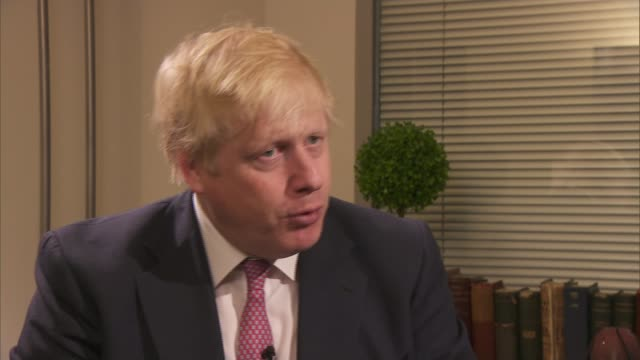 donald trump to make paris climate change decision england london int boris johnson interview sot let's see what he does before we start condemning/... - richard pallot stock-videos und b-roll-filmmaterial