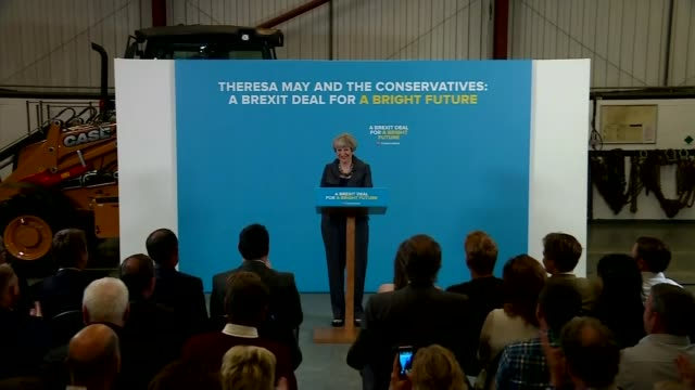 donald trump to make paris climate change decision; england: teeside: int theresa may speaking at campaign rally press conference question and answer... - paris agreement stock videos & royalty-free footage