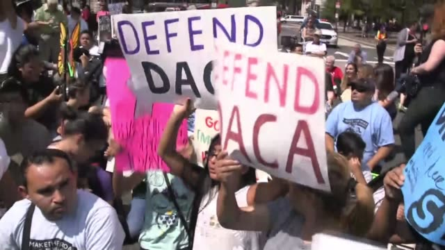 donald trump to scrap dreamers young immigrants scheme usa washington ext demonstrators with megaphone chanting sot protesters chanting sot 'defend... - emigration and immigration stock videos & royalty-free footage