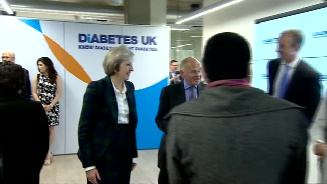 Donald Trump transition arrangements / President elect meets Japanese Prime Minister ENGLAND London Theresa May MP along at Diabetes event