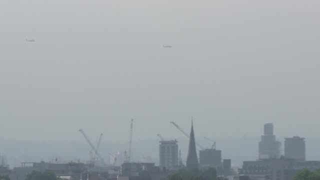 marine one helicopter flies over parliament hill and city of london england london marine one helicopter escorts and osprey helicopters flying over... - parliament hill stock videos & royalty-free footage