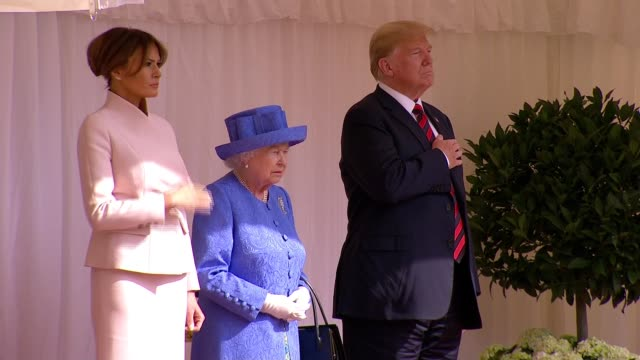 day 2 trump meets the queen at windsor castle england london windsor castle ext band play us national anthem / queen elizabeth ii and donald trump... - guard of honour stock videos and b-roll footage