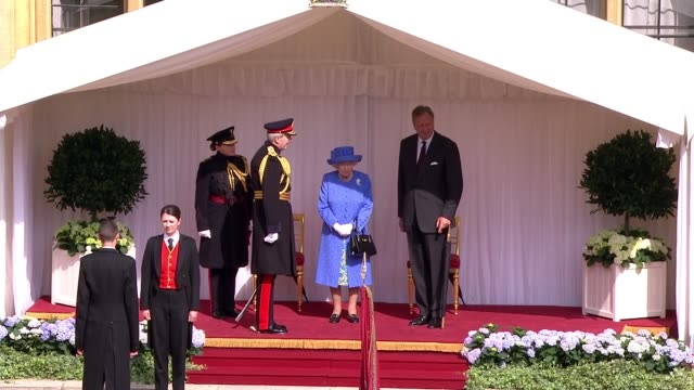 day 2 trump meets the queen at windsor castle england london windsor castle ext queen elizabeth ii waiting / motorcade arriving / donald trump and... - windsor england stock videos and b-roll footage