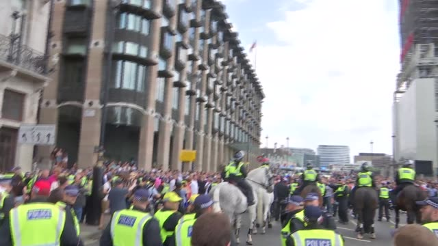 pro Trump and 'Free Tommy Robinson' protests in London / clashes with police ENGLAND London Whitehall EXT Various of clashes between proRobinson...