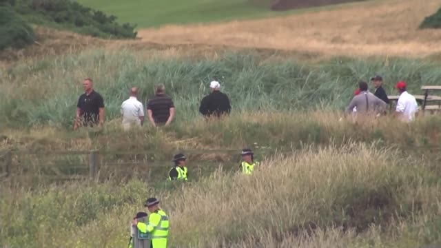 Trump met with protests during golf trip in Scotland UK Scotland Anti Donald Trump protesters police officers at Turberry Golf club as Donald Trump...