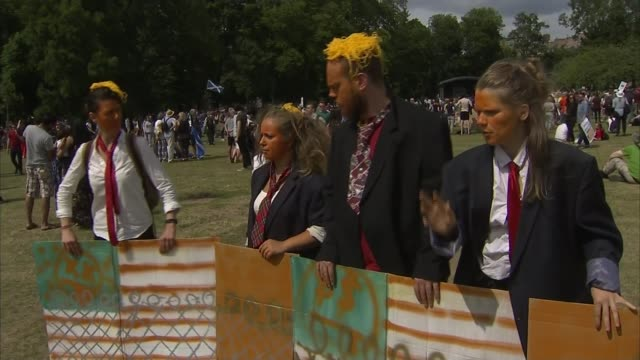 Trump met with protests during golf trip in Scotland Edinburgh The Meadows Trump balloon as deflated AntiTrump protesters with faces painted orange...