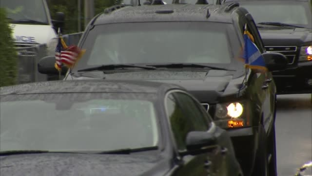 Trump departs Turnberry SCOTLAND Turnberry EXT Convoy of cars including Donald Trump limousine leaves Turnberry golf course / few people at roadside...
