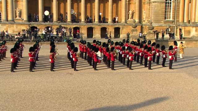 donald trump uk visit: trump arrival at blenheim palace; england: oxfordshire: blenheim palace: ext band of the scots guards playing in palace... - oxfordshire stock videos & royalty-free footage