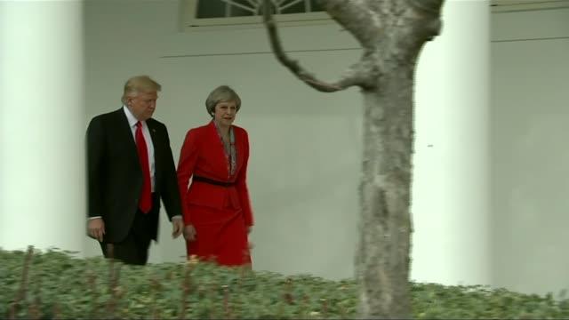 Donald Trump warns Iran not to resume nuclear program LIB / Washington DC The White House EXT Donald Trump and Theresa May MP along colonnade FREEZE...