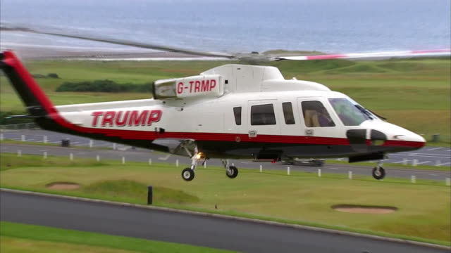 donald trumps helicopter arrives at his golf course in turnberry, scotland to greet supporters with his daughter ivanka and son eric. - healthcare and medicine or illness or food and drink or fitness or exercise or wellbeing stock videos & royalty-free footage