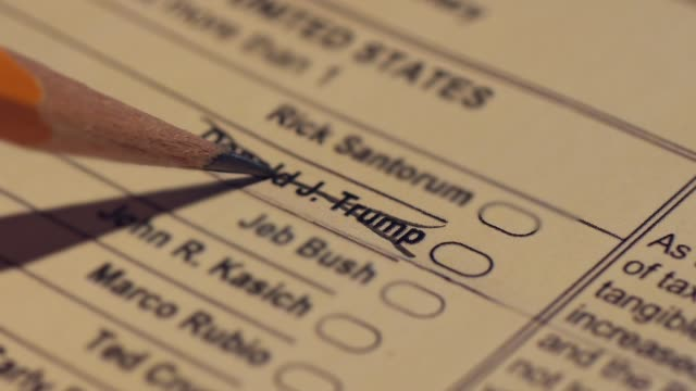donald trump's name is crossed off a republican primary ballot by an angry voter making a statement - us republican party 2016 presidential candidate stock videos & royalty-free footage
