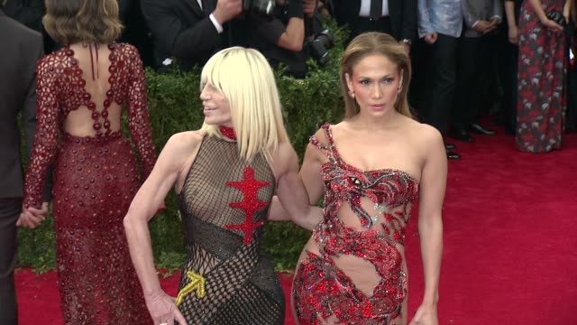 "donatella versace and jennifer lopez at ""china: through the looking glass"" costume institute benefit gala - arrivals at metropolitan museum of art on... - versace designer label stock videos & royalty-free footage"