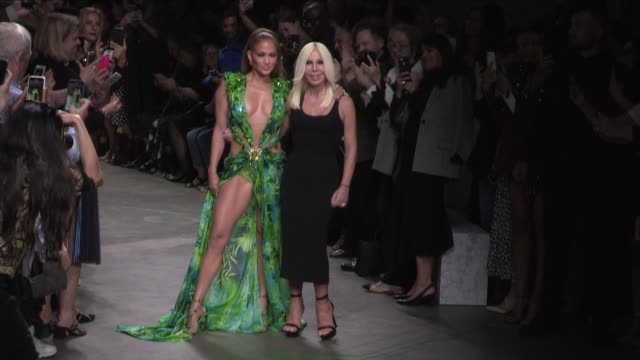 donatella versace and jennifer lopez on the runway for the versace ready to wear spring summer 2020 fashion show in milan milan, italy on friday,... - versace designer label stock videos & royalty-free footage