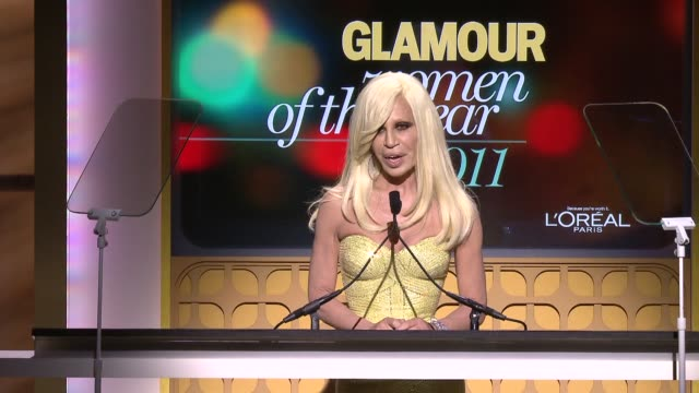 donatella versace introduces jennifer lopez at the glamour magazine's 21st annual women of the year awards at new york ny. - versace designer label stock videos & royalty-free footage