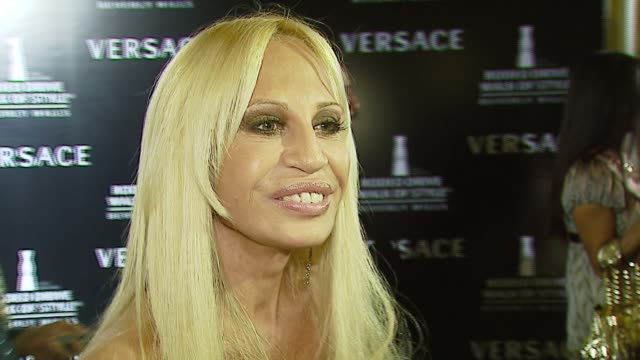 donatella versace on the award, and how hollywood inspires her at the rodeo walk of style award presentation to gianni and donatella versace at... - ヴェルサーチ点の映像素材/bロール