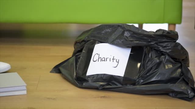 donating to charity - altruism stock videos & royalty-free footage