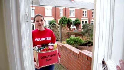 donating unwanted goods - volunteer stock videos & royalty-free footage