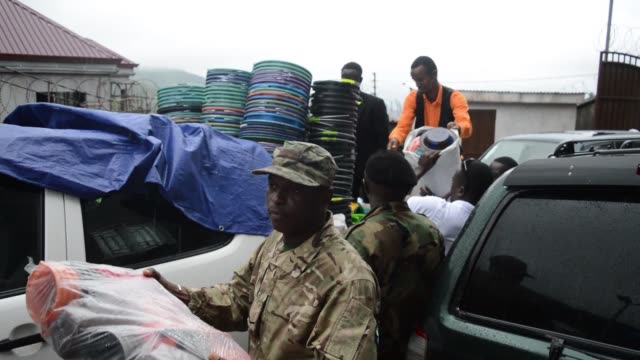 Donations are distributed to response workers at the mudslide in Sierra Leone that claimed more than 300 lives