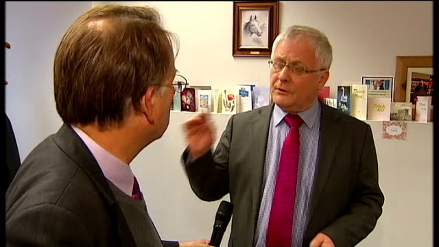 Doncaster to vote on abolishing post of Mayor Peter Davies and ITN Reporter chatting in office Framed photograph of Davis with horse at racetrack...
