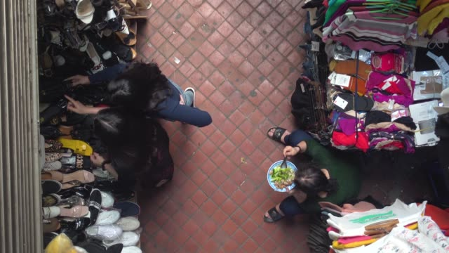 dong xuan market at hanoi, vietnam. clothing market stall directly above high angle view - optical illusion stock videos & royalty-free footage
