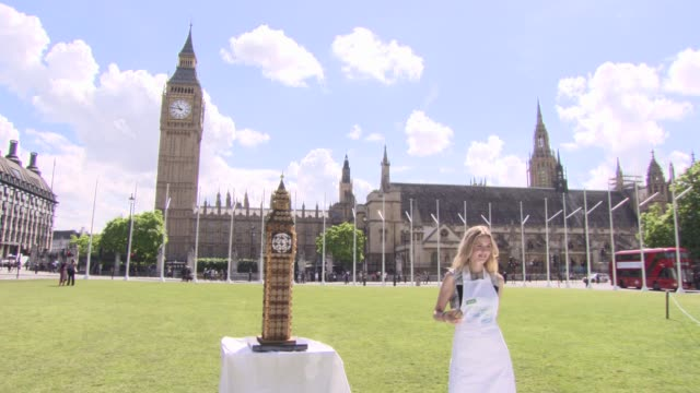 CLEAN Donna Air and Alzheimer's Society create giant Big Ben in cupcakes to mark Cupcake Day in Parliament Square photocall at Parliament Square on...