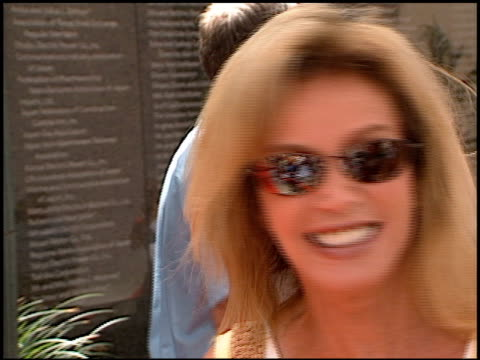 donna mills at the 'when dinosaurs roamed america' premiere at the los angeles county museum of art in los angeles, california on july 7, 2001. - ロサンゼルスカウンティ美術館点の映像素材/bロール
