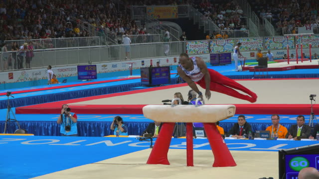 donnell whittenburg in the pommel horse. the 2015 pan american games, officially the xvii pan american games, were a major international multi-sport... - all around competition stock videos & royalty-free footage