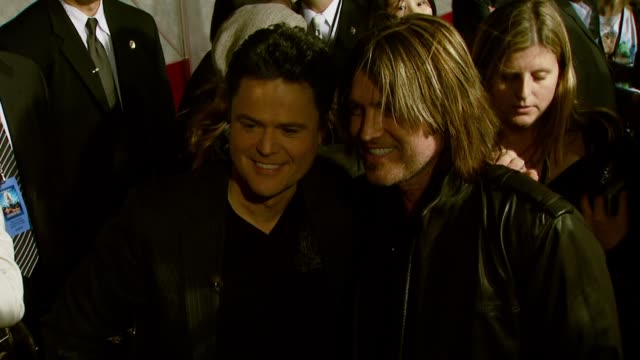 Donny Osmond and Billy Ray Cyrus at the 'Hannah Montana Miley Cyrus Best of Both Worlds Concert 3D' Premiere at the El Capitan Theatre in Hollywood...