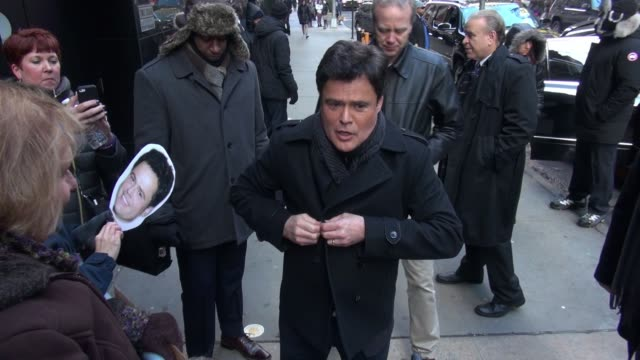 Donny Osmond leaves the Good Morning America show signs for fans in Celebrity Sightings in New York