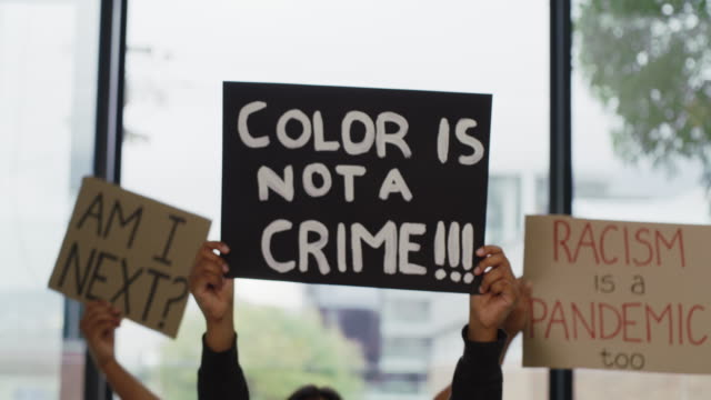 don't let colour divide us - protestor stock videos & royalty-free footage