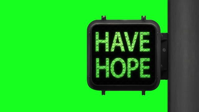 vídeos y material grabado en eventos de stock de no te asustes. have hope—medium shot of green walk signal with hopeful phrase - luz verde semáforo