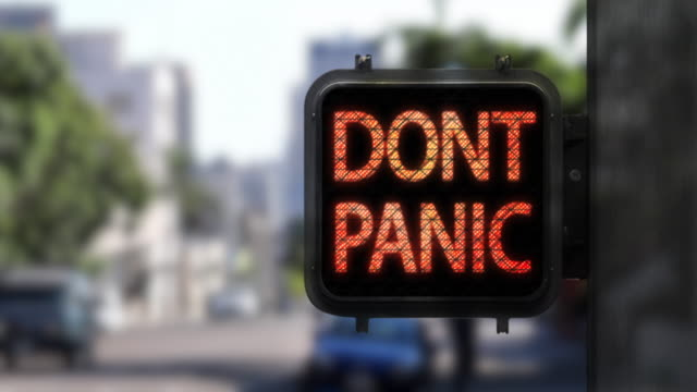 don't panic. live life—medium shot of walk signal with hopeful phrase - pedestrian stock videos & royalty-free footage