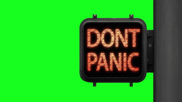 don't panic. stay safe—chroma key shot of green walk signal with hopeful phrase with green screen in the background - green light stock videos & royalty-free footage