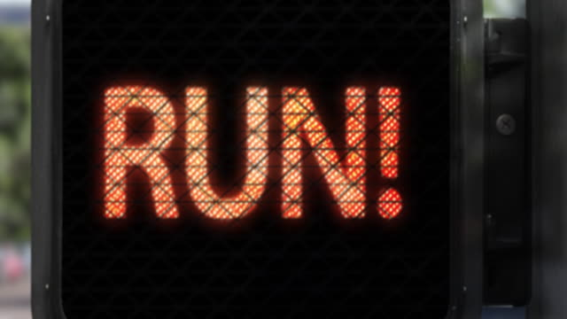 don't walk. run!—closeup of walk signal with fun phrase in red letters - road sign stock videos & royalty-free footage