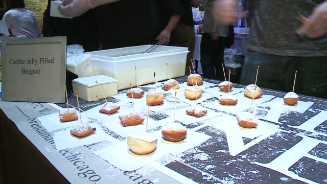 wgn donut holes being powdered at donut fest 2016 in chicago on january 31 2016 - doughnut stock videos & royalty-free footage