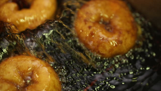 cu slo mo donuts frying in oil/ johannesburg/ south africa - plain stock videos & royalty-free footage