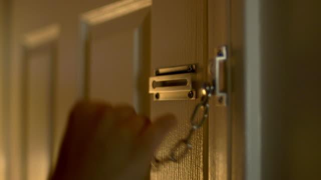 cu door being unlocked. - sicurezza video stock e b–roll