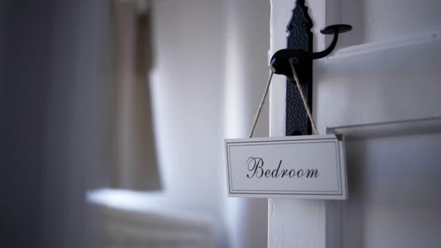 door hanger bedroom decoration - hanging sign stock videos and b-roll footage