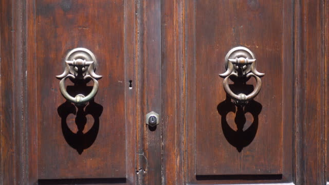 door knockers in the village of orvieto, tuscany, italy, europe. - door knocker stock videos & royalty-free footage